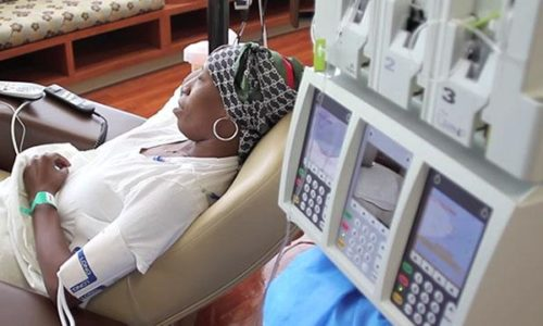 woman-with-headscarf-getting-chemo-treatment-article